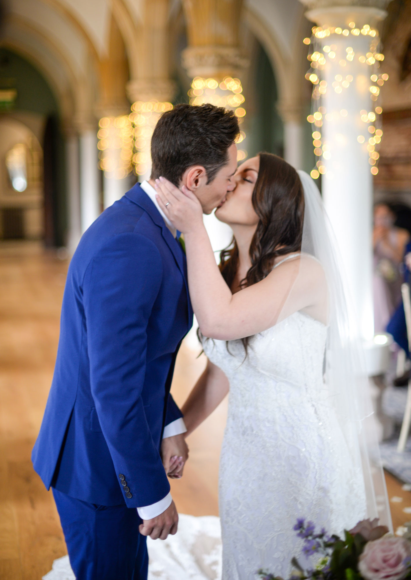 Bride and Groom kissing in Ceremony at Wedding Photo Wotton House